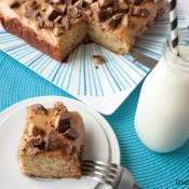 Banana Snack Cake | Crumbs and Chaos Easy banana snack cake topped with creamy peanut butter and chopped Reeses  #banana #recipe #peanutbutter www.crumbsandchaos.net