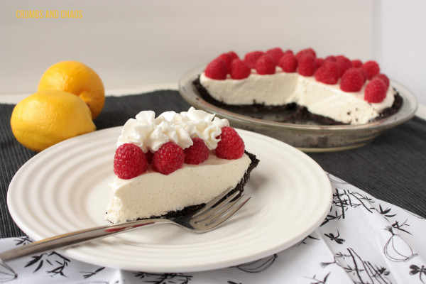 Lemon-Raspberry Ice Box Pie | Crumbs and Chaos  An incredible pie - creamy lemon filling perfectly complemented by tart raspberries and Oreo cookie crust.  #pie #lemon #Oreo  www.crumbsandchaos.net